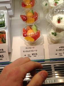 Tiny fruit cups...Notice how big my hand is in comparison to the cup...I guess it really is true that many Japanese think small things are cute.